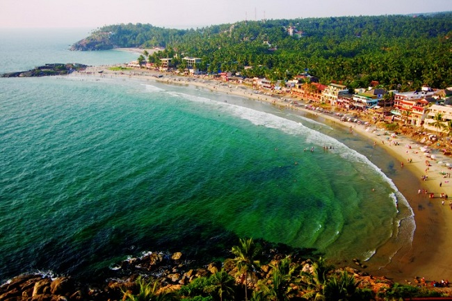 Crescent shaped Kovalam Beach Image courtesy: Kerala Tourism Board